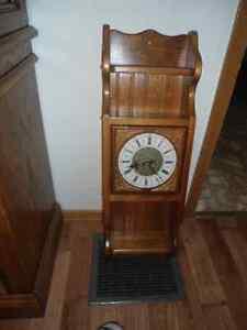 Clock  in wooden cabinet