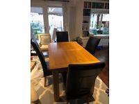 Solid Oak Dinner table with chairs.