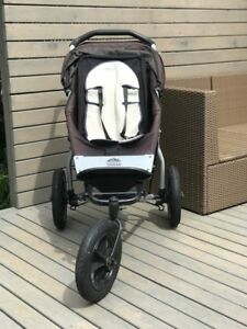 Well used Mountain Buggy Stroller w/ rain cover for sale