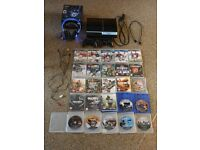 Playstation3 console, wireless headset and 25 games bundle.