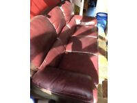 Burgundi Leather sofa with leg rest on both sides. Almost like new. No damages.