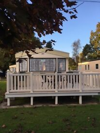 A well maintained 2004 ABI Arizona Static Caravan situated on Hoburne Bashley Park in Sway.