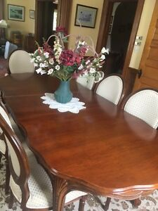 Solid Wood dining room table with extensions and chairs