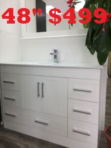"BATHROOM VANITY 48"" $499. SHOWER DOOR. BATHHTUB"