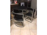 "Kitchen ""new"" table with the manufacturer tag-4 chairs"