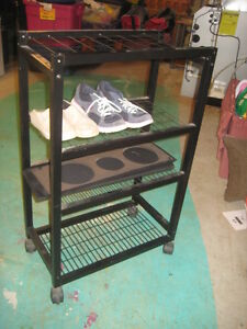 Black metal shelf on wheels great condition
