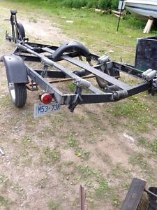 Tilt Boat trailer with adjustable rollers.