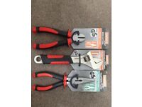 Set of three brand new hand tools pliers, side cutters and adjustable spanner