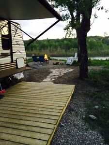 2015 30ft trailer set up on banks of Waterton River