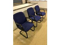 Three blue office chairs