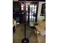 Brown Wooden/Steel Coat Hanger with a Granite base. Great looking and in excellent quality!