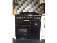 Black RANGEMASTER 90 freestanding cooker with matching hood