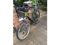 Trek Mountain Bicycle. Good condition. £125. 24 Speeds. Good tires, good seat, cool lights