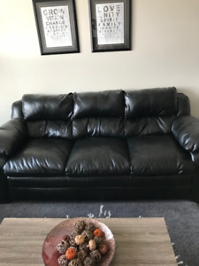 Black Couch and Rocking Chair