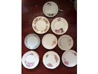 Assortment of small vintage plates and saucers