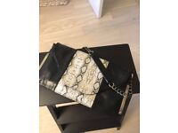Fiorelly clutch leather bag with a metal chain