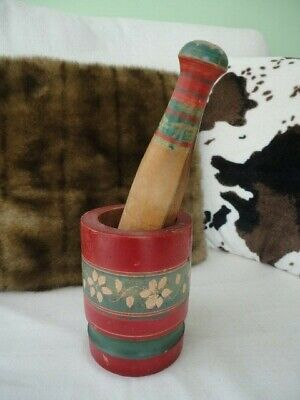 Antique painted wooden pestle and mortar