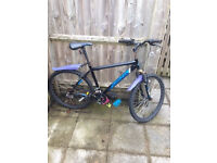Mountain bike in very good condition. Includes pump, helmet, and seat cover