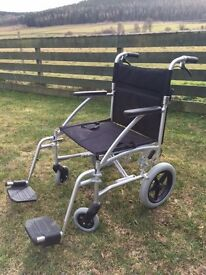 Lighweight foldable transit wheelchair