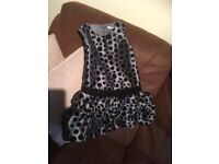 Silvery grey dress with black velvet spots and trim.