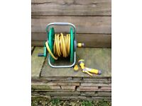 Hozelock hose reel + fittings for sale. Approx. 11m