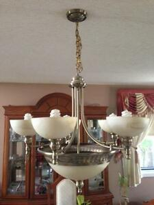 $300 · Two light fixtures for dinning room and front entrence.