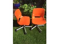 Two Orange IKEA Swivel Chairs