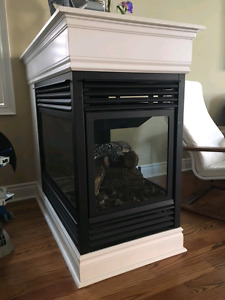 3 sided gas  fireplace and mantel