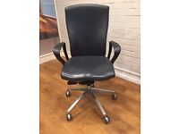 Good quality grey leather office swivel chair