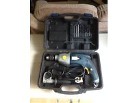 Titan SF16DL 850W Impact Drill in Case with selection of bits. Nearly New