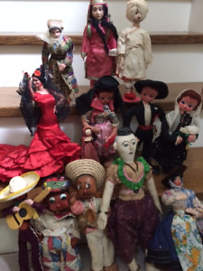 Fourteen collectors dolls from around the world