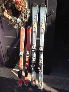 2 pairs of atomic downhill skis for sale