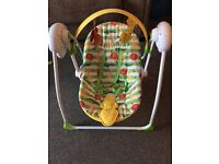 Mothercare safari battery operated swing chair with music.