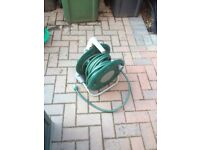 Water hose on reel for the garden
