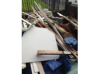 Free for collection old carpet, red bricks breeze blocks, some wood
