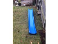 Curved play slide