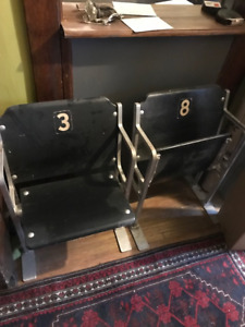 two vintage fold up chairs from stadium/auditorium
