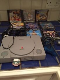 Sony playstation 1 plus 8 games
