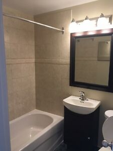 BRIGHT TWO BEDROOM WITH NEW LAMINATE FLOORS - $500 GROCERY CARD!