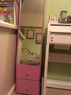 Pink standing mirror with drawers
