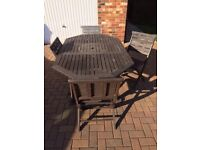 WOODEN GARDEN TABLE & 4 CHAIRS with seat cushions
