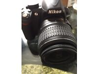 Nikon D3100 + 18-55mm Nikkor lens and 32gb SD card