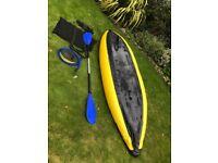 Eskimo style inflatable kayak with professional paddle