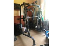 Marcy Smith SM4000 gym machine + set of free weights.