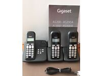Gigaset AS300A answering machine and 3 cordless phones