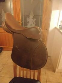 **TWO LEATHER GP SADDLES FOR SALE**