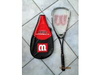 Wilson Titanium T1 Raquet complete with case and sports bag (used a couple of times)