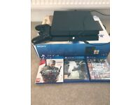 Playstation 4 1TB memory with dual shock controller, cables and three games. Mint condition!