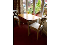 Extending dining table with two chairs