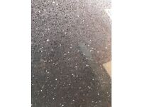 Kitchen worktop and upstand like black sparkling granite